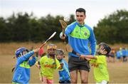 19 July 2018; Dublin hurler Danny Sutcliffe surprised youngsters taking part in one of the county's most popular Kellogg's GAA Cúl Camps with a visit to Éire Óg in Wicklow recently. In attendance with Danny Sutcliffe are participants, from left, Ruth Howard, age 6, Katie Brady, age 6, David Thomas, age 6, and Brian Kelly, age 6. Danny joined in what was an action-packed morning of activity and fun, teaching the children GAA skills, sharing great insider tips and promoting the importance of active play. More than 142,000 children took part in Kellogg's GAA Cúl Camps last year.  The camps are for children aged 6 – 13 years who can enjoy a week of on-the-pitch action learning new skills, making new friends, being active and having fun during the school holidays in July and August. Kellogg's involvement with Cúl Camps stems from its commitment to promoting and encouraging physical activity.  Educating children on the importance of nutrition to support active play is a key component of Cúl Camps and Kellogg's believes in the power of breakfast to fuel activity both on and off the pitch. The camps are in full swing and surprise visits will take place across all provinces during the summer. For more information parents can log on to www.kelloggsculcamps.gaa.ie Photo by Stephen McCarthy/Sportsfile