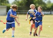 18 July 2018; Hayden Coyle passes the ball to team-mate Erin Fitzpatrick during the Bank of Ireland Leinster Rugby Summer Camp at Portlaoise RFC in Togher, Portlaoise, Co. Laois. Photo by Matt Browne/Sportsfile