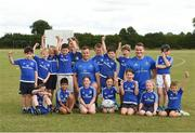 18 July 2018; Leinster player's Bryan Byrne and Peter Dooley with children from the summer camp during the Bank of Ireland Leinster Rugby Summer Camp at Portlaoise RFC in Togher, Portlaoise, Co. Laois. Photo by Matt Browne/Sportsfile