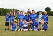 18 July 2018; Leinster player's Bryan Byrne and Peter Dooley with Leinster summer camp coach Katelynn Doran and children from the summer camp during the Bank of Ireland Leinster Rugby Summer Camp at Portlaoise RFC in Togher, Portlaoise, Co. Laois. Photo by Matt Browne/Sportsfile