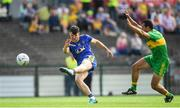 21 July 2018; Diarmuid Murtagh of Roscommon shoots at goal despite the attention of Frank McGlynn of Donegal during the GAA Football All-Ireland Senior Championship Quarter-Final Group 2 Phase 2 match between Roscommon and Donegal at Dr Hyde Park in Roscommon. Photo by Ramsey Cardy/Sportsfile