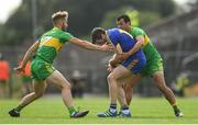 21 July 2018; Cathal Cregg of Roscommon is tackled by Stephen McMenamin, left, and Frank McGlynn of Donegal during the GAA Football All-Ireland Senior Championship Quarter-Final Group 2 Phase 2 match between Roscommon and Donegal at Dr Hyde Park in Roscommon. Photo by Ramsey Cardy/Sportsfile