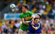 21 July 2018; Hugh McFadden of Donegal in action against Niall Kilroy, left, and John McManus of Roscommon during the GAA Football All-Ireland Senior Championship Quarter-Final Group 2 Phase 2 match between Roscommon and Donegal at Dr Hyde Park in Roscommon. Photo by David Fitzgerald/Sportsfile