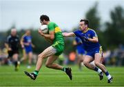 21 July 2018; Odhrán Mac Niallais of Donegal in action against Niall Kilroy of Roscommon during the GAA Football All-Ireland Senior Championship Quarter-Final Group 2 Phase 2 match between Roscommon and Donegal at Dr Hyde Park in Roscommon. Photo by David Fitzgerald/Sportsfile