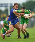 21 July 2018; Jamie Brennan of Donegal is tackled by Enda Smith of Roscommon during the GAA Football All-Ireland Senior Championship Quarter-Final Group 2 Phase 2 match between Roscommon and Donegal at Dr Hyde Park in Roscommon. Photo by Ramsey Cardy/Sportsfile
