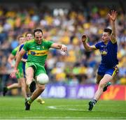 21 July 2018; Michael Murphy of Donegal kicks a point despite the attempted block from Niall McInerney of Roscommon during the GAA Football All-Ireland Senior Championship Quarter-Final Group 2 Phase 2 match between Roscommon and Donegal at Dr Hyde Park in Roscommon. Photo by David Fitzgerald/Sportsfile