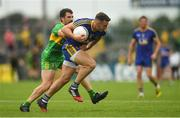 21 July 2018; John McManus of Roscommon is tackled by Paddy McGrath of Donegal during the GAA Football All-Ireland Senior Championship Quarter-Final Group 2 Phase 2 match between Roscommon and Donegal at Dr Hyde Park in Roscommon. Photo by Ramsey Cardy/Sportsfile