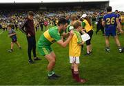 21 July 2018; Ryan McHugh of Donegal signs a shirt for a supporter following the GAA Football All-Ireland Senior Championship Quarter-Final Group 2 Phase 2 match between Roscommon and Donegal at Dr Hyde Park in Roscommon. Photo by Ramsey Cardy/Sportsfile