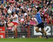 21 July 2018; Richard Donnelly of Tyrone  in action against Eoin Murchan of Dublin during the GAA Football All-Ireland Senior Championship Quarter-Final Group 2 Phase 2 match between Tyrone and Dublin at Healy Park in Omagh, Tyrone. Photo by Ray McManus/Sportsfile