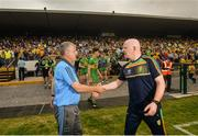 21 July 2018; Roscommon manager Kevin McStay, left, shakes hands with Donegal manager Declan Bonner following the GAA Football All-Ireland Senior Championship Quarter-Final Group 2 Phase 2 match between Roscommon and Donegal at Dr Hyde Park in Roscommon. Photo by David Fitzgerald/Sportsfile