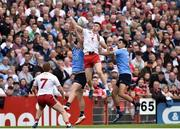 21 July 2018; Cathal McShane of Tyrone in action against Michael Darragh Macauley, left, and Cian O'Sullivan of Dublin during the GAA Football All-Ireland Senior Championship Quarter-Final Group 2 Phase 2 match between Tyrone and Dublin at Healy Park in Omagh, Tyrone. Photo by Oliver McVeigh/Sportsfile