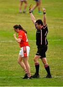 21 July 2018; Aine O'Sullivan of Cork is shown a yellow card by referee Stephen McNulty during the TG4 All-Ireland Senior Championship Group 2 Round 2 match between Cork and Monaghan at St Brendan's Park in Birr, Co. Offaly.  Photo by Brendan Moran/Sportsfile