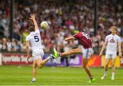 22 July 2018; Michael Daly of Galway kicks a point, despite the attention of Johnny Byrne of Kildare during the GAA Football All-Ireland Senior Championship Quarter-Final Group 1 Phase 2 match between Kildare and Galway at St Conleth's Park in Newbridge, Co Kildare. Photo by Sam Barnes/Sportsfile