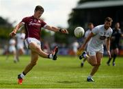 22 July 2018; Seán Armstrong of Galway kicks a point under pressure from Johnny Byrne of Kildare during the GAA Football All-Ireland Senior Championship Quarter-Final Group 1 Phase 2 match between Kildare and Galway at St Conleth's Park in Newbridge, Co Kildare. Photo by Piaras Ó Mídheach/Sportsfile