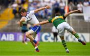 22 July 2018; Darren Hughes of Monaghan is tackled by David Moran of Kerry during the GAA Football All-Ireland Senior Championship Quarter-Final Group 1 Phase 2 match between Monaghan and Kerry at St Tiernach's Park in Clones, Monaghan. Photo by Brendan Moran/Sportsfile