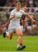 22 July 2018; Peter Kelly of Kildare gets past Cathal Sweeney of Galway during the GAA Football All-Ireland Senior Championship Quarter-Final Group 1 Phase 2 match between Kildare and Galway at St Conleth's Park in Newbridge, Co Kildare. Photo by Piaras Ó Mídheach/Sportsfile