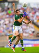 22 July 2018; David Moran of Kerry in action against Darren Hughes of Monaghan during the GAA Football All-Ireland Senior Championship Quarter-Final Group 1 Phase 2 match between Monaghan and Kerry at St Tiernach's Park in Clones, Monaghan. Photo by Ramsey Cardy/Sportsfile