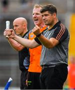 22 July 2018; Kerry manager Eamonn Fitzmaurice, right, and selector Liam Hassett celebrate his side's only goal of the game, scored by David Clifford, during the GAA Football All-Ireland Senior Championship Quarter-Final Group 1 Phase 2 match between Monaghan and Kerry at St Tiernach's Park in Clones, Monaghan. Photo by Brendan Moran/Sportsfile