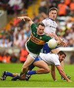 22 July 2018; Mark Griffin of Kerry in action against Drew Wylie of Monaghan and Niall Kearns during the GAA Football All-Ireland Senior Championship Quarter-Final Group 1 Phase 2 match between Monaghan and Kerry at St Tiernach's Park in Clones, Monaghan. Photo by Philip Fitzpatrick/Sportsfile