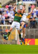 22 July 2018; Kieran Donaghy of Kerry fields a high ball ahead of Vinny Corey of Monaghan during the GAA Football All-Ireland Senior Championship Quarter-Final Group 1 Phase 2 match between Monaghan and Kerry at St Tiernach's Park in Clones, Monaghan. Photo by Brendan Moran/Sportsfile