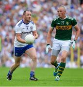 22 July 2018; Vinny Corey of Monaghan in action against Kieran Donaghy of Kerry during the GAA Football All-Ireland Senior Championship Quarter-Final Group 1 Phase 2 match between Monaghan and Kerry at St Tiernach's Park in Clones, Monaghan. Photo by Brendan Moran/Sportsfile