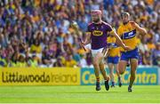 14 July 2018; Paudie Foley of Wexford in action against Cathal Malone of Clare during the GAA Hurling All-Ireland Senior Championship Quarter-Final match between Clare and Wexford at Páirc Ui Chaoimh in Cork. Photo by Brendan Moran/Sportsfile