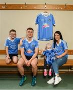 24 July 2018; AIG Insurance has today announced a Dublin GAA jersey takeover, children's charity Aoibheann's Pink Tie's logo will appear on the Dublin GAA jerseys for an upcoming football, ladies football and camogie fixture this summer. Dublin playerJohn Small along with Evie Groves, age 2, right, who benefited from the childrens charity Aoibheann's Pink Tie with her mother Lorraine and her brother Sean Groves, age 8, left, were on hand today to launch Aoibheann's Pink Tie Dublin GAA jersey takeover in Parnell Park. Photo by David Fitzgerald/Sportsfile
