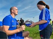 25 July 2018; Leinster's Devin Toner signs a ball for a camp participant during the Bank of Ireland Leinster Rugby Summer Camp at Cill Dara RFC in Kildare. Photo by Seb Daly/Sportsfile