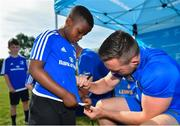 25 July 2018; Leinster's Jack Conan signs a jersey for a camp participant during the Bank of Ireland Leinster Rugby Summer Camp at Cill Dara RFC in Kildare. Photo by Seb Daly/Sportsfile