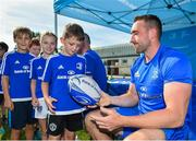 25 July 2018; Leinster's Jack Conan signs a ball for a camp participant during the Bank of Ireland Leinster Rugby Summer Camp at Cill Dara RFC in Kildare. Photo by Seb Daly/Sportsfile