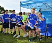 25 July 2018; Leinster's Jack Conan, right, signs a jersey for a camp participant during the Bank of Ireland Leinster Rugby Summer Camp at Cill Dara RFC in Kildare. Photo by Seb Daly/Sportsfile