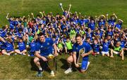 25 July 2018; Leinster players James Ryan and Andrew Porter with camp participants during the Bank of Ireland Leinster Rugby Summer Camp at Clondalkin RFC in Dublin. Photo by David Fitzgerald/Sportsfile