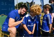 25 July 2018; Leinster player James Ryan with camp participants during the Bank of Ireland Leinster Rugby Summer Camp at Clondalkin RFC in Dublin. Photo by David Fitzgerald/Sportsfile
