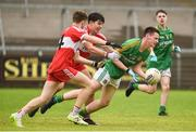 28 July 2018; Niall Bennett of Meath in action against Enda Downey and Iarlaith Donaghy of Derry during the Electric Ireland GAA Football All-Ireland Minor Championship Quarter-Final match between Meath and Derry at the Athletic Grounds in Armagh. Photo by Oliver McVeigh/Sportsfile