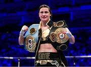 28 July 2018; Katie Taylor celebrates with both championship belts following her WBA & IBF World Lightweight Championship bout with Kimberly Connor at The O2 Arena in London, England. Photo by Stephen McCarthy/Sportsfile