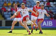 7 July 2018; Frank Burns of Tyrone in action against Ronan O'Toole and Paul Kerrigan of Cork during the GAA Football All-Ireland Senior Championship Round 4 between Cork and Tyrone at O'Moore Park in Portlaoise, Co. Laois. Photo by Brendan Moran/Sportsfile