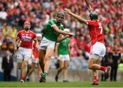 29 July 2018; Gearóid Hegarty of Limerick scores a point under pressure from Mark Coleman of Cork during the GAA Hurling All-Ireland Senior Championship semi-final match between Cork and Limerick at Croke Park in Dublin. Photo by Piaras Ó Mídheach/Sportsfile