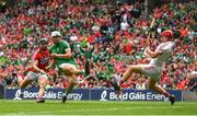 29 July 2018; Aaron Gillane of Limerick scores a point despite the attention of Anthony Nash of Cork during the GAA Hurling All-Ireland Senior Championship semi-final match between Cork and Limerick at Croke Park in Dublin. Photo by Ramsey Cardy/Sportsfile