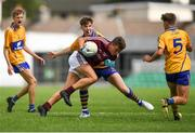 29 July 2018; Aidan Halloran of Galway in action against Cillian Rouine of Clare during the Electric Ireland GAA Football All-Ireland Minor Championship Quarter-Final between Galway and Clare at Bord Na Mona O'Connor Park in Tullamore, Co Offaly. Photo by Harry Murphy/Sportsfile