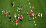 29 July 2018; Referee Paud O'Dwyer performs the coin toss in the company of captains Declan Hannon of Limerick and Seamus Harnedy of Cork before the start of extra time during the GAA Hurling All-Ireland Senior Championship semi-final match between Cork and Limerick at Croke Park in Dublin. Photo by Brendan Moran/Sportsfile