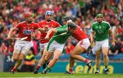 29 July 2018; Peter Casey of Limerick is tackled by Christopher Joyce of Cork, who is supported by team mates Bill Cooper, 8, and Sean O'Donoghue during the GAA Hurling All-Ireland Senior Championship semi-final match between Cork and Limerick at Croke Park in Dublin. Photo by Ray McManus/Sportsfile