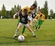 29 July 2018; John McGuiness of Roscommon Cubs in action against Mohamed Mugtaba of Mullingar Athletic, during Ireland's premier underaged soccer tournament, the Volkswagen Junior Masters. The competition sees U13 teams from around Ireland compete for the title and a €2,500 prize for their club, over the days of July 28th and 29th, at AUL Complex in Dublin. Photo by Seb Daly/Sportsfile