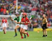 29 July 2018; Grace Kelly, St Mary's Draperstown, Magherafelt, Derry, representing Cork, in action against Niamh Duffy, Coldwood National School, Craughwell, Co. Galway, representing Limerick, during the INTO Cumann na mBunscol GAA Respect Exhibition Go Games at the GAA Hurling All-Ireland Senior Championship semi-final match between Cork and Limerick at Croke Park in Dublin. Photo by Ray McManus/Sportsfile