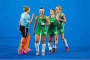 29 July 2018; Ireland players, from left, Grace O'Flanagan, Elena Tice, Lizzie Colvin and Zoe Wilson after the Women's Hockey World Cup Finals Group B match between England and Ireland at Lee Valley Hockey Centre, QE Olympic Park in London, England. Photo by Craig Mercer/Sportsfile