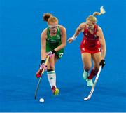 29 July 2018; Zoe Wilson of Ireland under pressure from Suzy Petty of England during the Women's Hockey World Cup Finals Group B match between England and Ireland at Lee Valley Hockey Centre, QE Olympic Park in London, England. Photo by Craig Mercer/Sportsfile