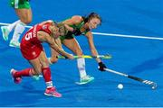 29 July 2018; Yvonne O'Byrne of Ireland battles for possession with Alex Danson of England during the Women's Hockey World Cup Finals Group B match between England and Ireland at Lee Valley Hockey Centre, QE Olympic Park in London, England. Photo by Craig Mercer/Sportsfile