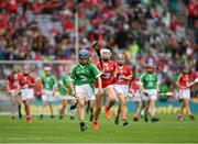 29 July 2018; Ciara Whelan-Barrett, Scoil Mhuire, Dungarvan, Co. Waterford, representing Limerick, in action against Holly Wall, Newtown Dunleckney, Carlow, representing Cork, during the INTO Cumann na mBunscol GAA Respect Exhibition Go Games at the GAA Hurling All-Ireland Senior Championship semi-final match between Cork and Limerick at Croke Park in Dublin. Photo by Ray McManus/Sportsfile