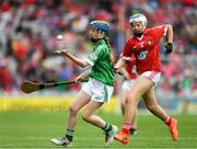 29 July 2018; Josie Mullen, Barntown National School, Wexford, representing Limerick, in action against Alison Donegan, Milford National School, Charleville, representing Cork,  during the INTO Cumann na mBunscol GAA Respect Exhibition Go Games at the GAA Hurling All-Ireland Senior Championship semi-final match between Cork and Limerick at Croke Park in Dublin. Photo by Ray McManus/Sportsfile