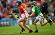 29 July 2018; Sophie Doyle, St Clare's Primary School, Harold's Cross, Dublin, representing Cork, in action against Alannah Maguire, St Mary's Primary School, Teemore, Co. Fermanagh, representing Limerick, during the INTO Cumann na mBunscol GAA Respect Exhibition Go Games at the GAA Hurling All-Ireland Senior Championship semi-final match between Cork and Limerick at Croke Park in Dublin. Photo by Piaras Ó Mídheach/Sportsfile