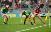 29 July 2018; Niamh Duffy, Coldwood National School, Craughwell, Co. Galway, representing Limerick, in action against Alison Donegan, Milford National School, Charleville, representing Cork, during the INTO Cumann na mBunscol GAA Respect Exhibition Go Games at the GAA Hurling All-Ireland Senior Championship semi-final match between Cork and Limerick at Croke Park in Dublin. Photo by Piaras Ó Mídheach/Sportsfile